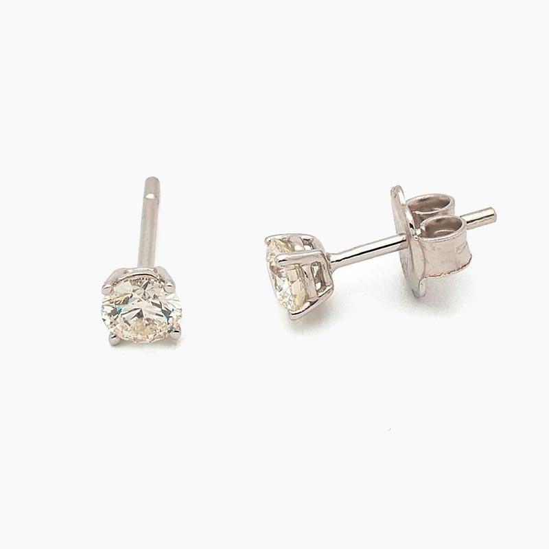 Pendientes de cuatro garras en oro blanco con diamantes