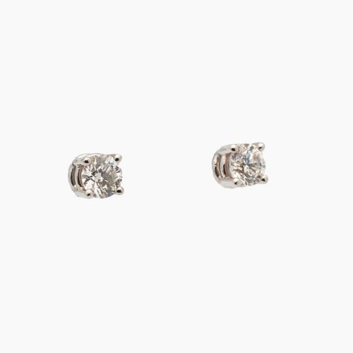 Pendientes de cuatro garras en oro blanco con diamantes B.49