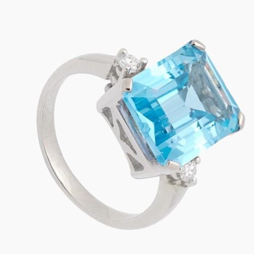 Sortija con topacio azul y diamantes