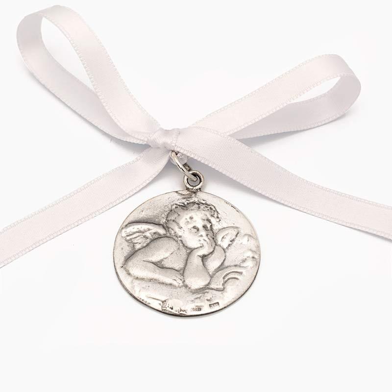 Medalla de cuna con angelote