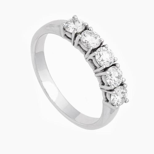 Sortija con cinco diamantes blancos...