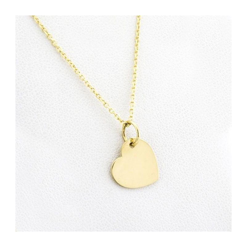 Cadena y colgante de corazón en oro de 18k.