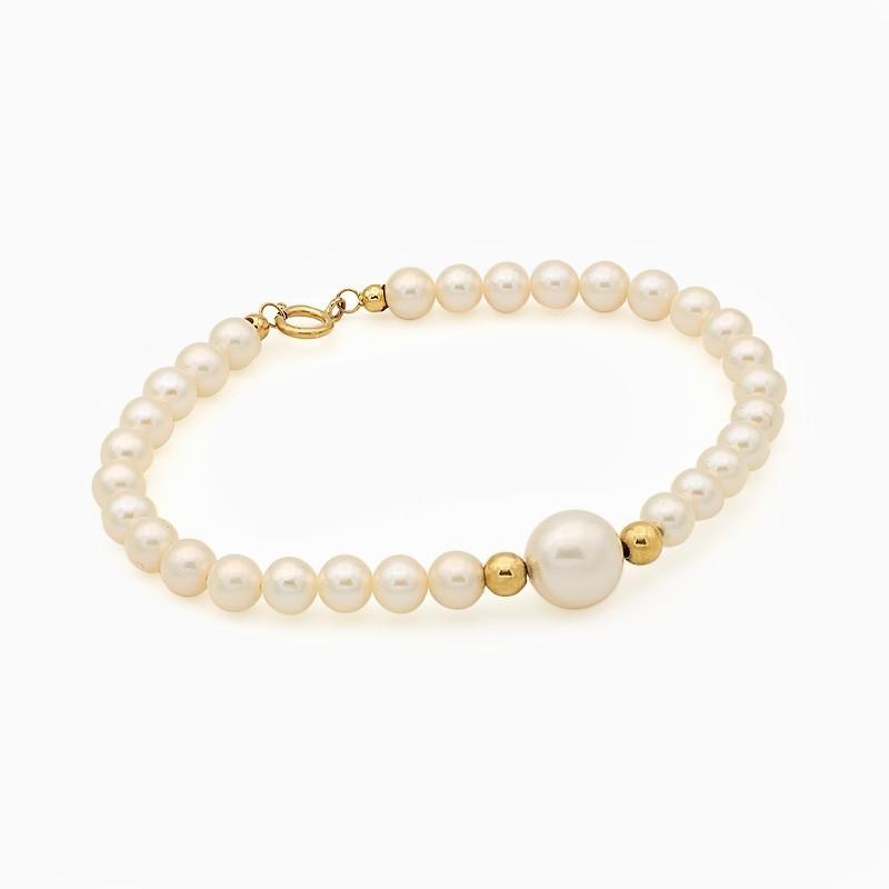 Pulsera de perlas con bolitas de oro amarillo
