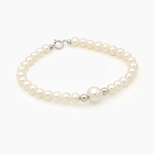 Pulsera de perlas con bolitas de oro blanco