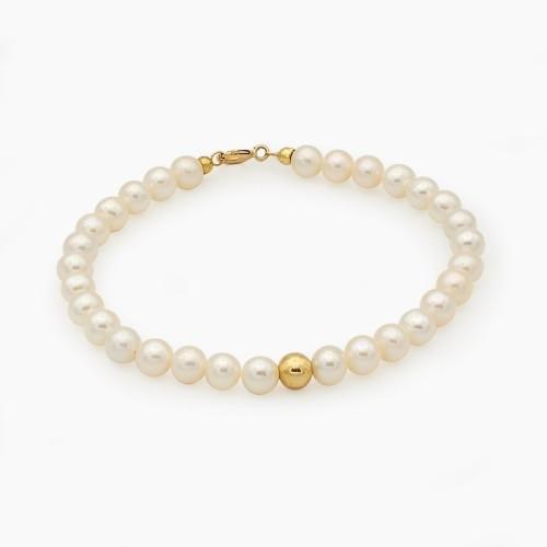 Pulsera de perlas con bolita central de oro amarillo