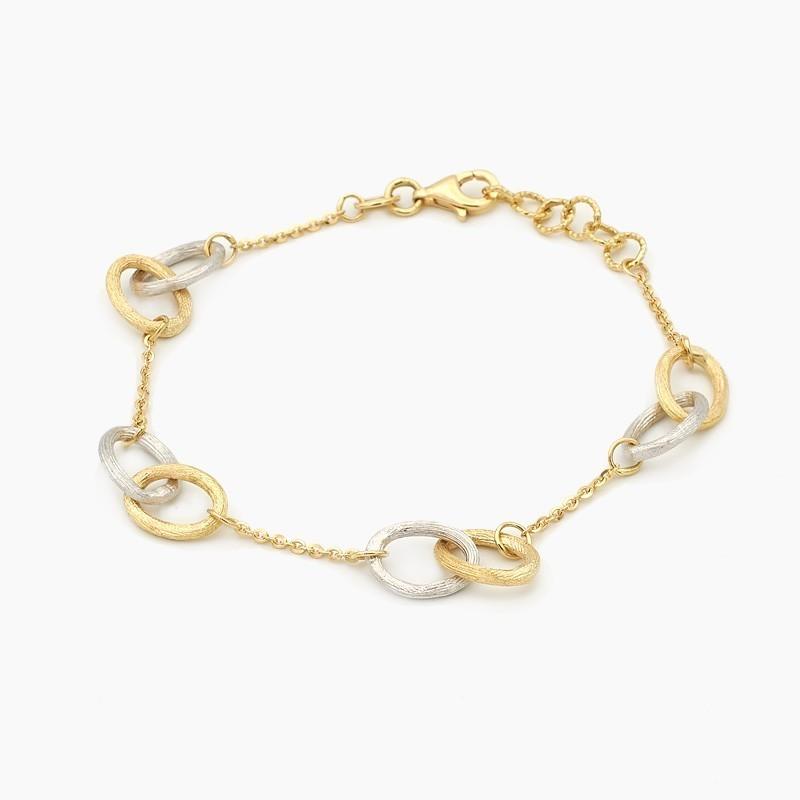Pulsera de anillos en oro bicolor